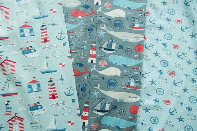 Swafing Jersey Simon mit maritimten Motiven: Leuchtturm, Boote, Wale, Anker und Möwen